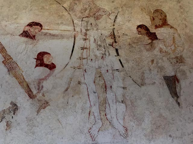 The Martyrdom of St Edmund, from a c. 14th wall painting, St Mary's church Troston