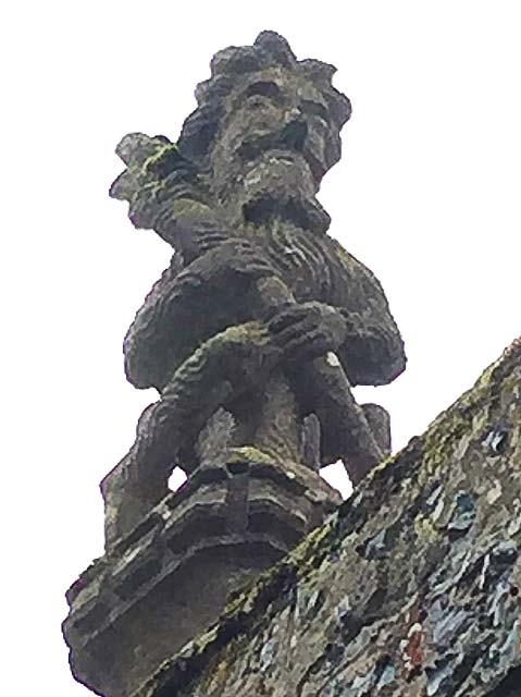 One of two wodewose on the north porch of St Mary's church, Mendlesham