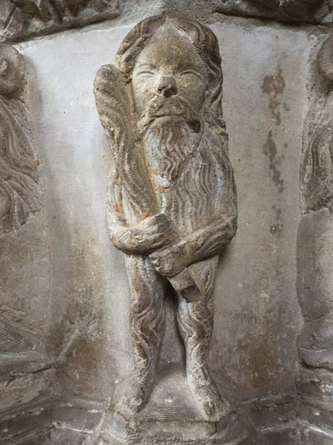 Carved stone wodewose, part of c. 15th font, St Bartholomew's Church, Orford