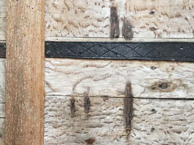 Black Shuck's claw-marks on the north door of the church